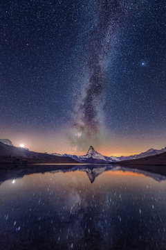 Milky way at lake Stellisee Matterhorn , Zermatt , Switzerland.
