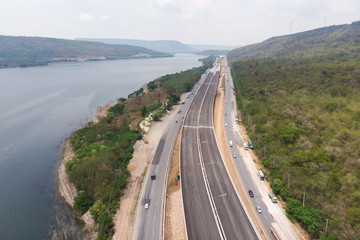 Drone shot aerial view landscape of under construction motorway tolls near big natural river
