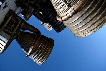 Large powerful booster rocket engines, blue sky background