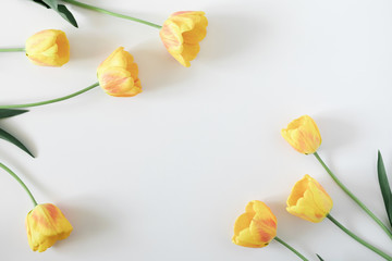 Beautiful composition of spring flowers. Yellow tulips flowers on white background. Valentine's Day, Easter, Birthday, Happy Women's Day, Mother's Day. Flat lay, top view, copy space Fotoväggar
