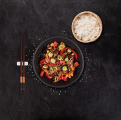 Szechuan beef asian food background with various ingredients on stone table.