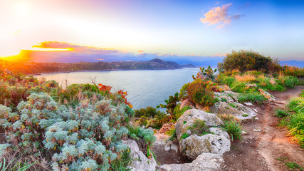 Dramatic spring sunset on the the cape Milazzo panorama of nature reserve Piscina di Venere. Wall mural