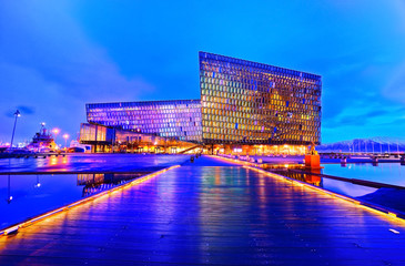 View of the Harpa Music Hall and Conference Centre with beautiful lights at night in Reykjavik, Iceland.