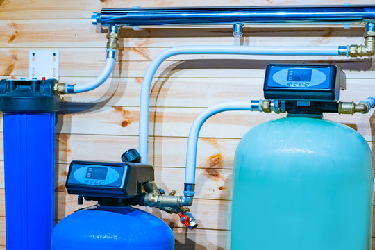 Water purification system in the house. Water filtration. Plumbing with filters. Drinking water. Sanitary work. Engineering networks in the house.