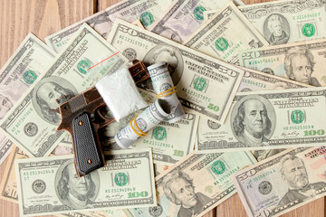 pistols and drugs against the background of dollars