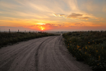Dirt road at sunrise, North Platte River valley, western Nebraska, USA