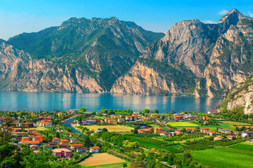 Wall Mural - Fantastic Torbole cityscape with plantations and lake Garda, Italy, Europe