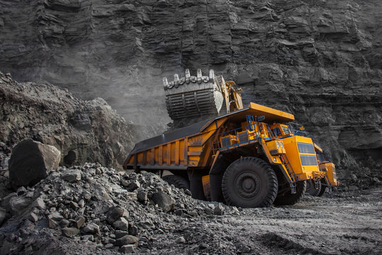 loader bucket on loading coal into a mining truck
