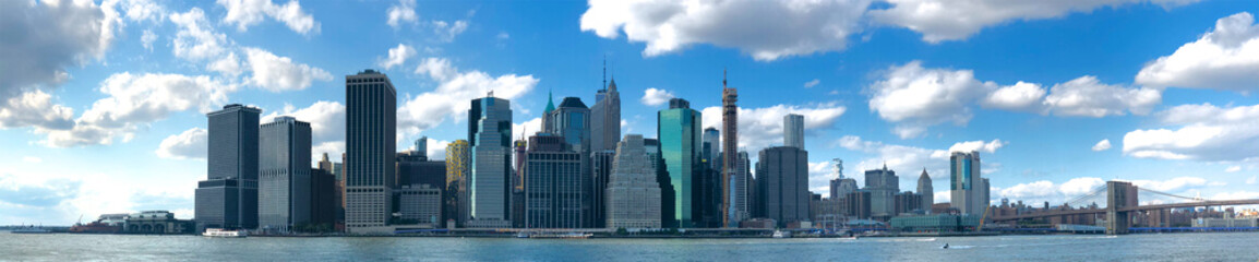 Stunning panoramic view of Manhattan Skyline, New York, USA. Panoramic Skyline with skyscrapers and financial district.