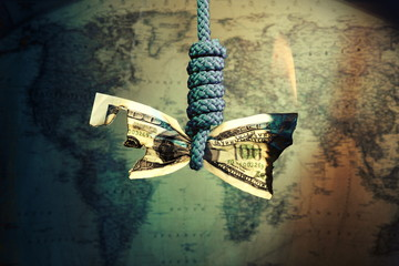 Burning and hanging Dollar,decrease. Global economic recession concept.World map in the background.