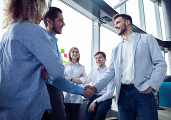 Business partnership meeting concept. Businessmen handshake. Successful businessmen handshaking after good deal.