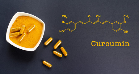 Curcumin formula with a  yellow turmeric root powder and capsules