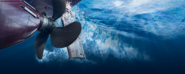 Propeller and rudder of big ship underway view from underwater. Close up image detail of ship. Wall mural