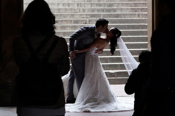 A bride and groom pose for photos in Central Park in New York