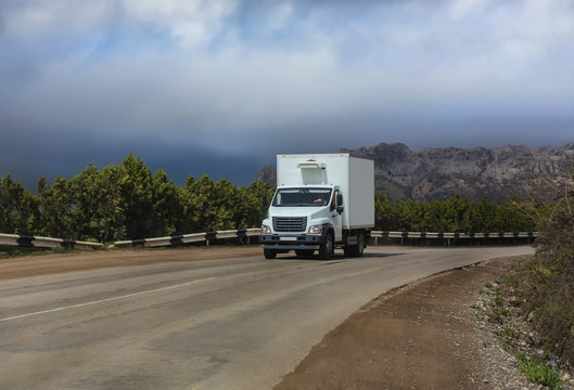 truck moves on a mountain road