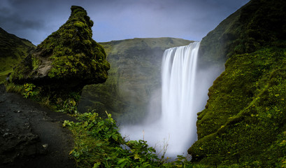 An elevated view of the Skógafoss waterfall in Iceland. A long exposure picture of the waterfall.