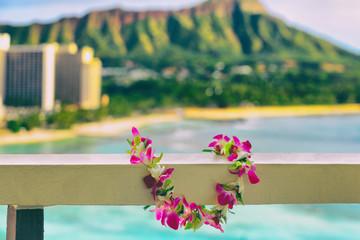 Hawaii background hawaiian flower lei with Waikiki beach landscape.