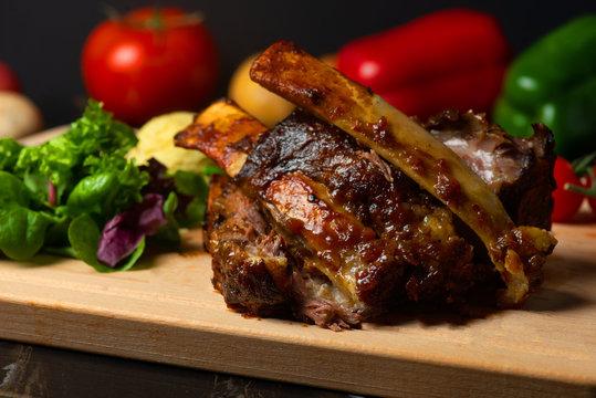 lamb ribs on dark background