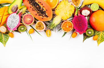 Still life with fresh assorted exotic fruits on a palm leaf. Wall mural