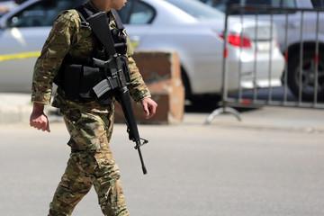 Lebanese soldier patrols Beirut street