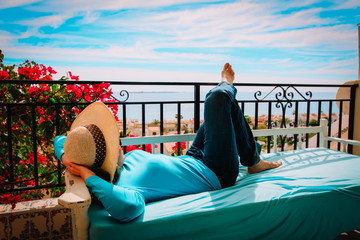 young woman relax on scenic balcony terrace