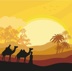 Bedouin camel caravan in wild africa landscape