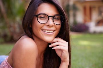 Beautiful glasses girl smiling to camera Wall mural