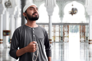 Religious muslim man praying in mosque