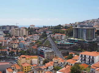 an aerial view of funchal in in madeira with roads running thought the center of the city and buildings in front of the sea