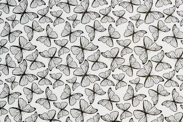 Arrière plan noir et blanc motif papillons