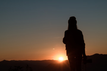 The silhouette of climbing with the camera looking at the sunset