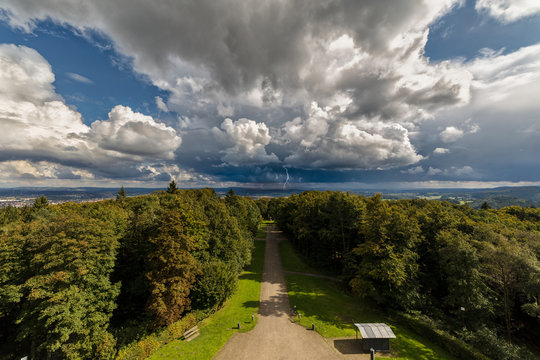 View from the Hermann Monument in the Teutoburg Forest in East Westphalia in the direction of Horn-Bad Meinberg with dramatic clouds and thunderstorms.
