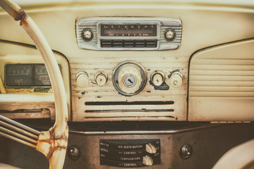 Retro styled image of an old car dashboard