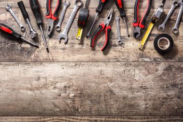 Building tools repair set on wooden background. Top view. Copyspace