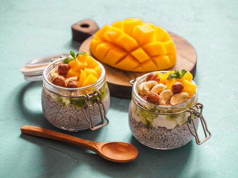 Chia seed pudding in jar with coconut milk, mango and nuts