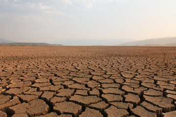 Dry river and lake after drought impact on summer, Landscape of Cracked earth metaphor climate change and drought