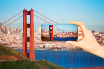 Hand take photo of San Francisco and Golden bridge