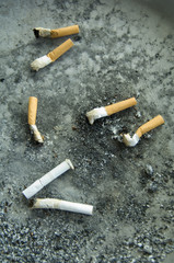 A pile of used cigarettes.