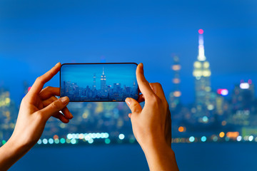Tourist take picture of New York panorama at night