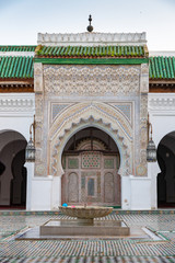 Beautiful tiles and geometry in Al Attarine Madrasa in Fes, Morocco