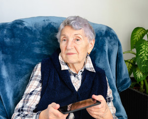 Elderly woman is very disappointed because she cannot use a smartphone