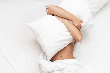 Woman in the bed don't want to wake up in morning Wall mural