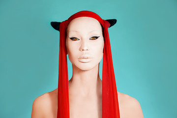 Creative Crazy glamor. Girl with white face. Trendy party Make-up, Accessory and Creative Hairstyle. Beautiful Woman