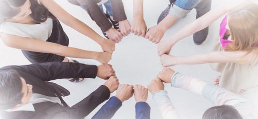Multicultural hands synergy brainstorm business man woman in circle top view. Support helping teamwork together international diversity race harmony education and people concept panoramic banner
