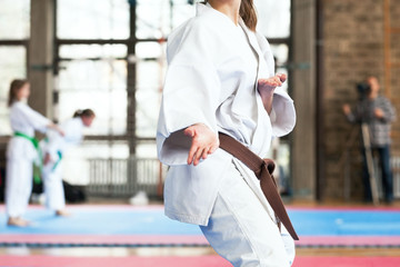 Female karate practitioner body position during competition. Martial arts. Wall mural