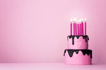 Pink birthday cake with candles Wall mural