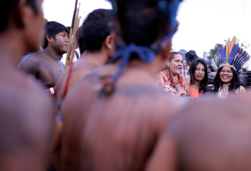 Indigenous Leader Sonia Guajajara is pictured with members of same tribe at the Terra Livre camp, or Free Land camp, in Brasilia