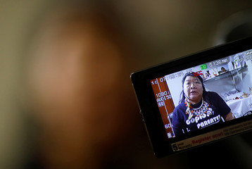 Indigenous Congresswoman Joenia Wapichana is projected on a camera screen as she talks during an interview with Reuters at the Terra Livre camp, or Free Land camp, in Brasilia