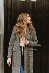 Woman standing near door on street