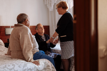 Daughter attending to her elderly mother with Alzheimer's
